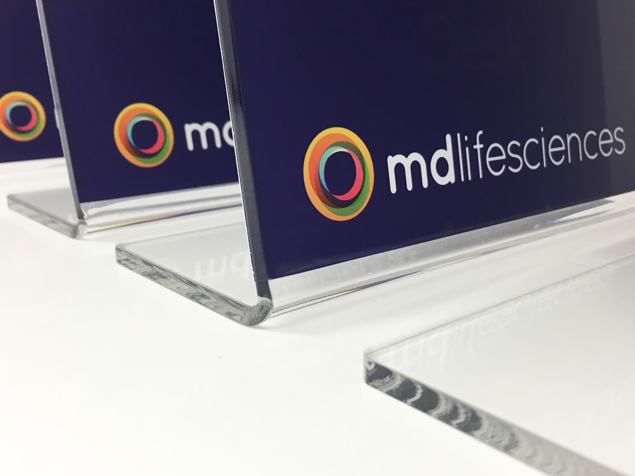 Acrylic reverse mounted signs