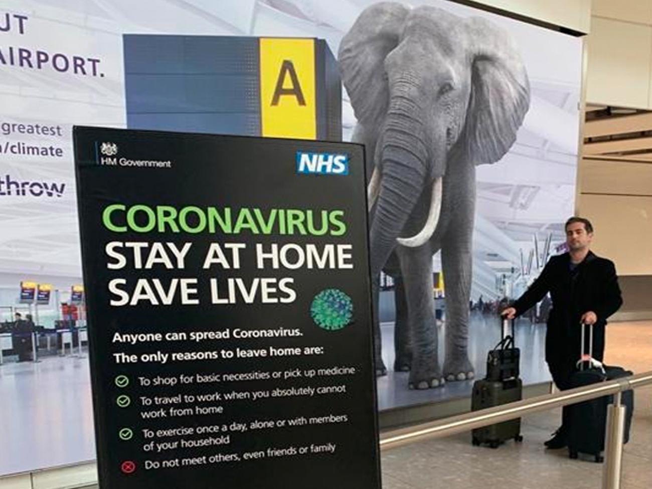 Airport arrivals covid-19 signage