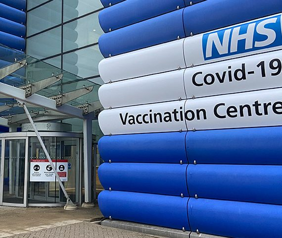 NHS Vaccination Centre Heathrow Building Branding