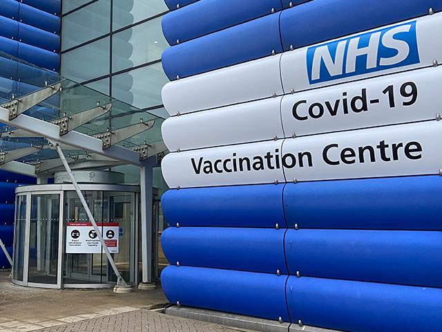 NHS Vaccination Centre Heathrow Building Branding